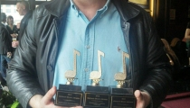 Scott Gwinnell proudly displaying his 2013 Detroit Music Award trophies.